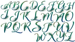Letters decorated with peacock feathers Royalty Free Stock Photos