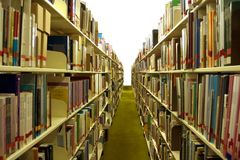 Library Aisle with Books Royalty Free Stock Photo