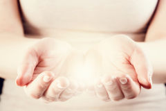 Light in woman hands. Giving, protect, care, energy Stock Photo