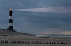 Lighthouse in the dusk Stock Photos