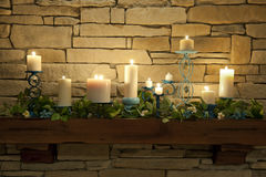 Lit Candles on a Mantle Piece Royalty Free Stock Photo