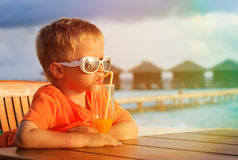 Little boy drinking cocktail on tropical beach Stock Photography