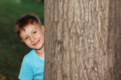 Little boy hide-and-seek Stock Images