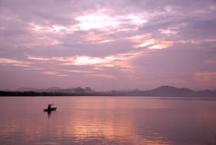 Little fish boat in the nightfall Stock Images