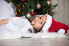Little girl on christmas with a tutu skirt Stock Image