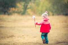 Little girl   day with  windmill Royalty Free Stock Photos