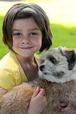 Little girl and a dog  Stock Photos