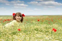 Little girl on wildflowers meadow spring season Royalty Free Stock Photos
