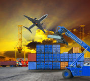 Logistic business working in container shipping yard with dusky sky and jet plane cargo flying above use for land to air transport Royalty Free Stock Photography