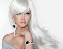 Long hair. Fashion Blond girl with white wavy hairstyle. Expensi Royalty Free Stock Image