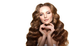 Long hair. Waves Curls Updo Hairstyle. Hair Salon. Fashion model Royalty Free Stock Images