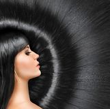 Long shiny hair of a beautiful brunette Stock Image