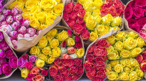 Lot of yellow,pink, red bouquets rose with wrapper in the market Stock Photo