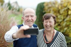 Love in focus. Happy senior couple bonding to each other and making selfie Stock Photo