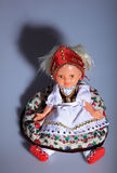 Lovely doll in folk cloth Royalty Free Stock Photos