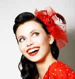 Vitality. Cheerful Young Woman with Red Bow enjoying. Pleasure Royalty Free Stock Photo