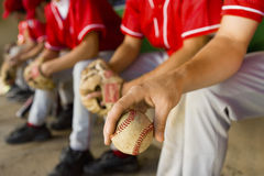 Low Section Of Baseball Team Mates Sitting In Dugout Stock Images
