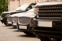 Luxury cars in a row Stock Photo