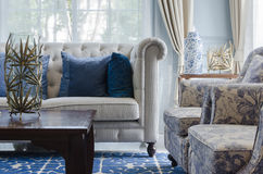 Luxury living room with sofa on blue pattern carpet at home Royalty Free Stock Image