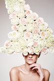 Luxury woman with a rose hat in fashion model pose Stock Photos