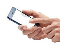 Mãos usando o telefone de pilha Foto de Stock Royalty Free