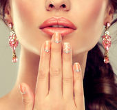Makeup for eyes and lips ,eyeliner and coral lipstick. Stock Image