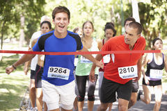Male Athlete Winning Marathon Race Royalty Free Stock Photography
