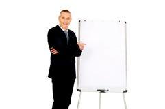 Male executive standing near flip chart Stock Photos