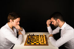 Males playing chess Royalty Free Stock Image