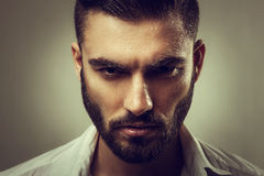 Man with a beard and wet face Stock Images