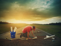 Man building a road Stock Photography