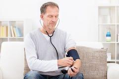 Man Checking Blood Pressure Stock Image