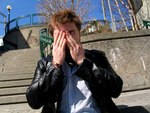 Man Covering Face Stock Images