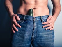 Man with cucumber down his pants Stock Photos