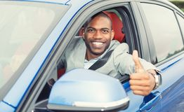 Man driver happy showing thumbs up coming out of car Royalty Free Stock Photography