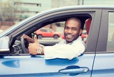 Man driver happy smiling showing thumbs up driving sport blue car Royalty Free Stock Photography