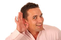 Man with Hand Cupped to Ear Royalty Free Stock Image