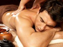 Man having back massage in the spa salon Royalty Free Stock Image