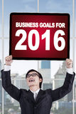 Man holds business goals for 2016 Royalty Free Stock Image