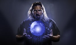 Man with hovering glowing orb Royalty Free Stock Photos
