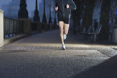 Man Jogging On City Pavement At Dawn Stock Photos