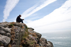 Man meditating on cliff top Royalty Free Stock Photo