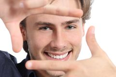 Man with perfect white smile framing face with hands Stock Images