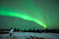 Man photographing the Aurora Borealis Stock Images