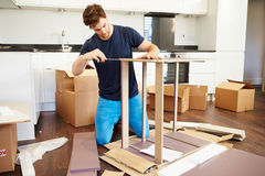 Man Putting Together Self Assembly Furniture In New Home Stock Photography