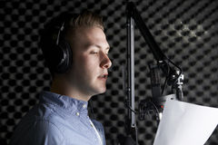 Man In Recording Studio Talking Into Microphone Stock Image