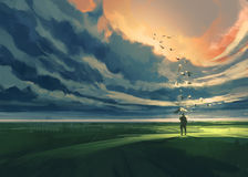 Man standing alone in the meadow Stock Images