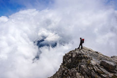 Man on top of mountain Stock Image