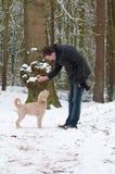 Man training puppy Stock Photo