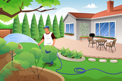 Man watering his grass and garden Royalty Free Stock Images